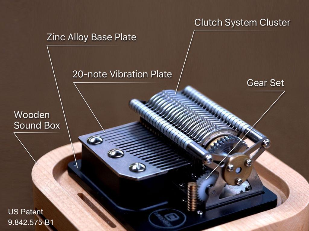 This image shows the mechanical design of Muro Box has flexible pins to pluck the comb according to any programmed music.